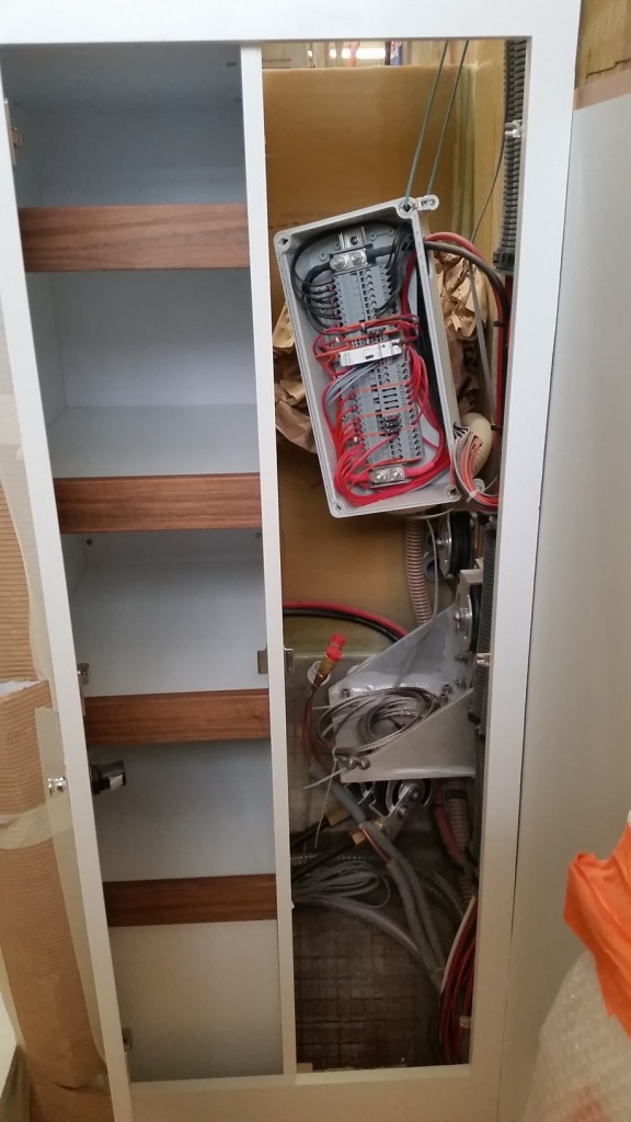 Electrical panel being installed in companionway compartment