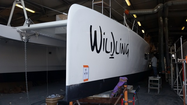 The boat name is on, the hull mold joins are faired and finished, and the bottom paint is complete.